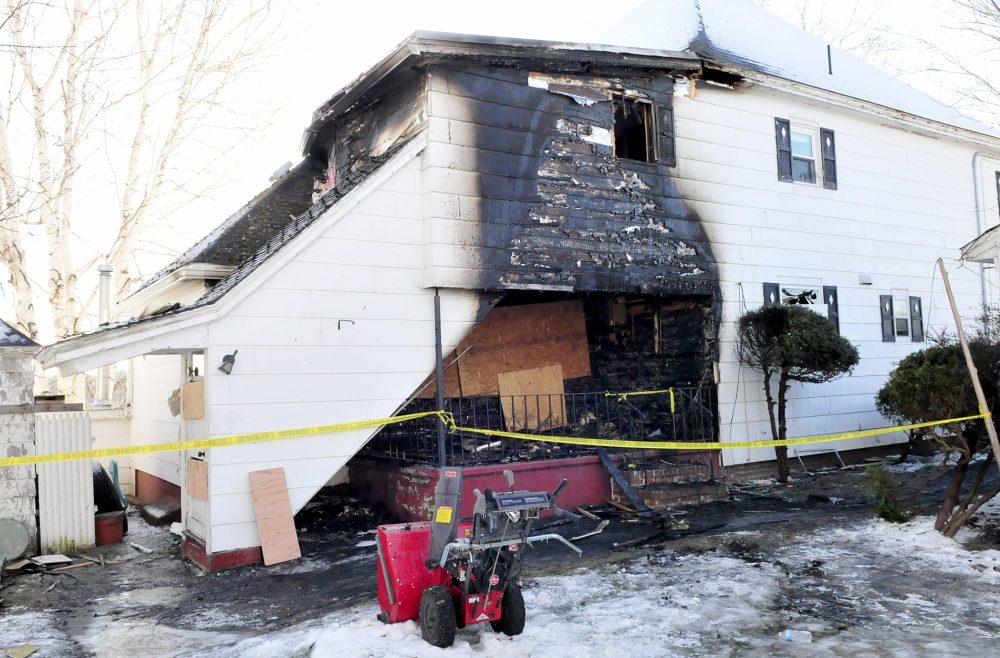 Staff photo by David Leaming DAMAGE: The back portion of this home at 1 Mount Pleasant Street in Waterville is blackened from fire that occurred on Wednesday evening, Dec. 11, 2013.