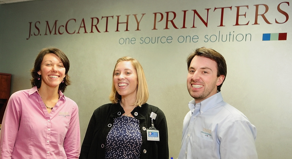 Employer mandate: Melanie Cooper, human resources manager, left, Kristen Simoneau, MaineGeneral health promotion specialist, and Michael Tardiff, director of communications, on Thursday at J.S. McCarthy Printers in Augusta.