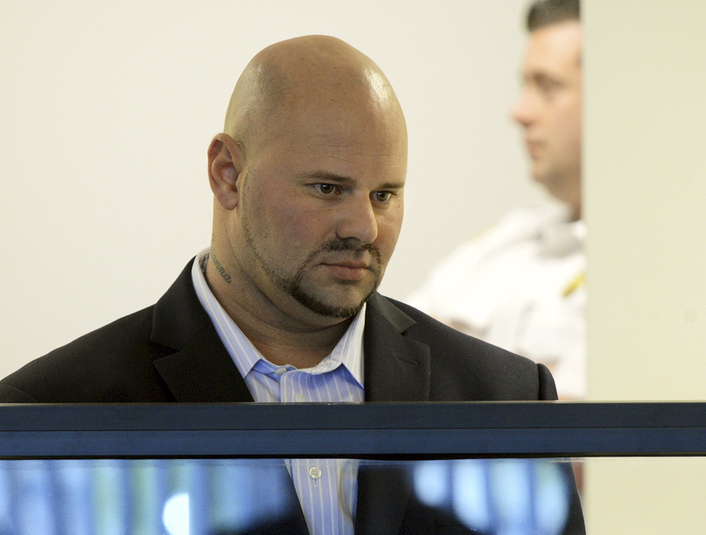 Jared Remy, son of Boston Red Sox broadcaster Jerry Remy, stands during arraignment in October at Middlesex Superior Court in Woburn, Mass., on murder and assault charges in the death of Jennifer Martel.