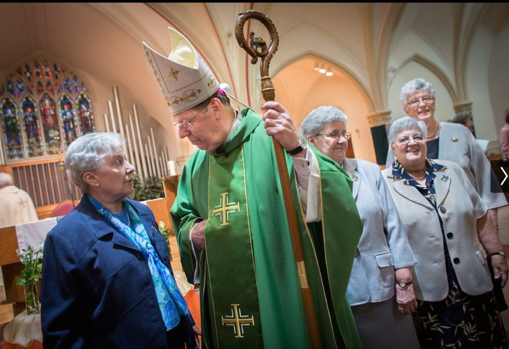 Sister Peggy Sullivan, left, talks with Deeley in October at St. Agatha's Church in Milton, Mass.