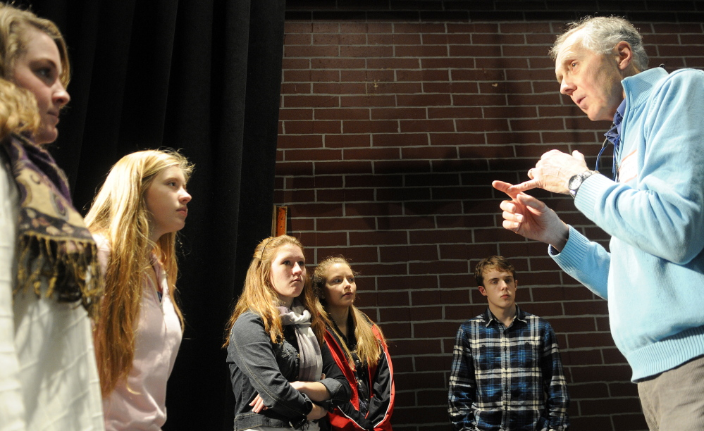 CONNECTED TO CULTURE: Larry Morissette directs choral students at Hall-Dale High School in Farmingdale. The singers were rehearsing two songs that were composed by Stan Keach, of Rome, and feature two Maine icons, Donn Fendler and Bean Boots by LL Bean.
