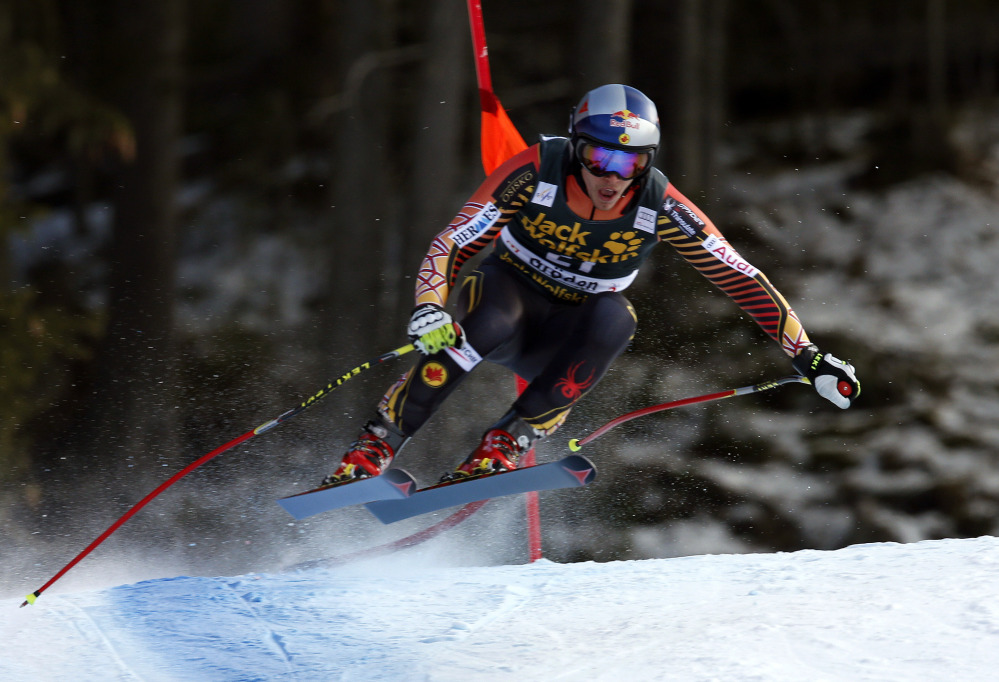 Canada's Erik Guay is airborne on his way to win an alpine ski, men's World Cup downhill, in Val Gardena, Italy.