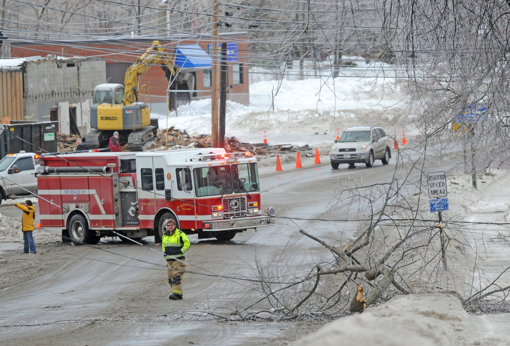 LINES DOWN: The Waterville Fire Department closed down a section of Main Street in downtown Waterville Monday afternoon after a branch broke under the strain of heavy ice.