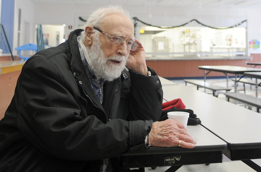 Staff photo by Andy Molloy SHELTER: Nunzio Biondello sips coffee Tuesday at the Carrie Ricker School in Litchfield, which opened as a shelter for residents of the down. The 89-year-old had been without either power or heat for a day.