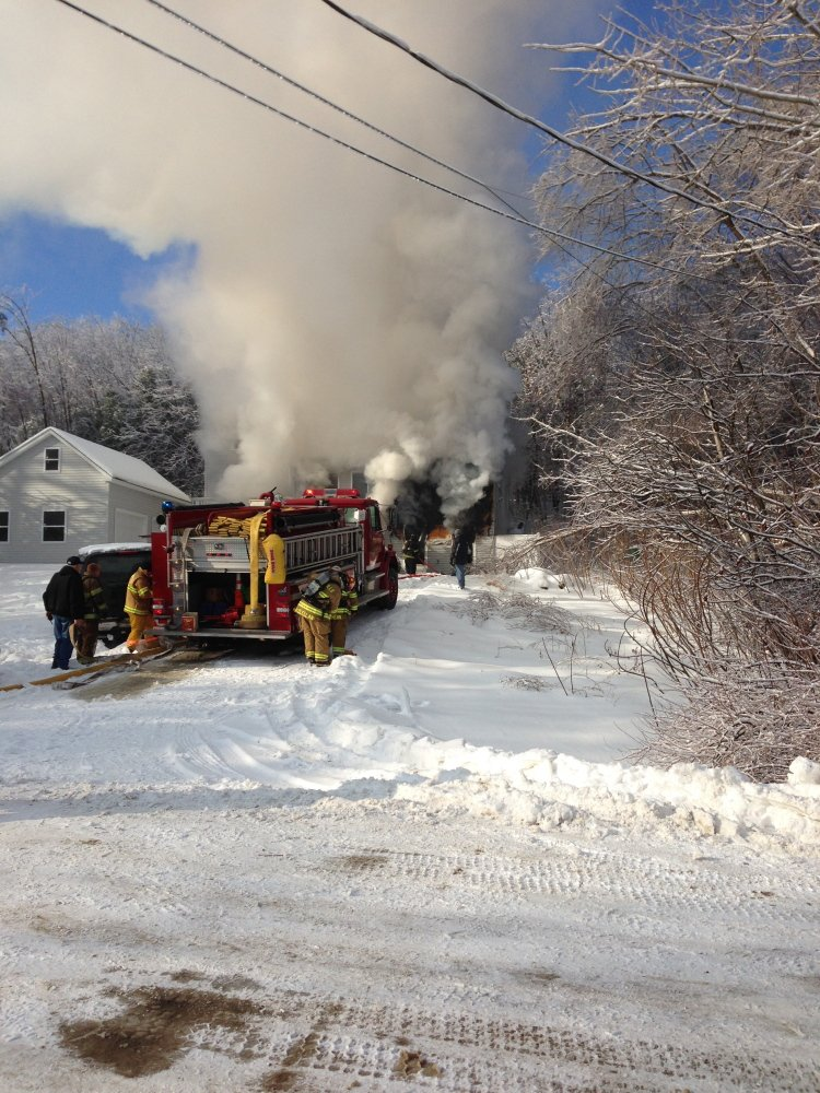 FIRE RESPONSE: Crews respond to a fire at Fire Road 14 in China Friday morning. Homeowner Neil Farrington saved his disabled brother-in-law from the blaze, but the home was a loss.