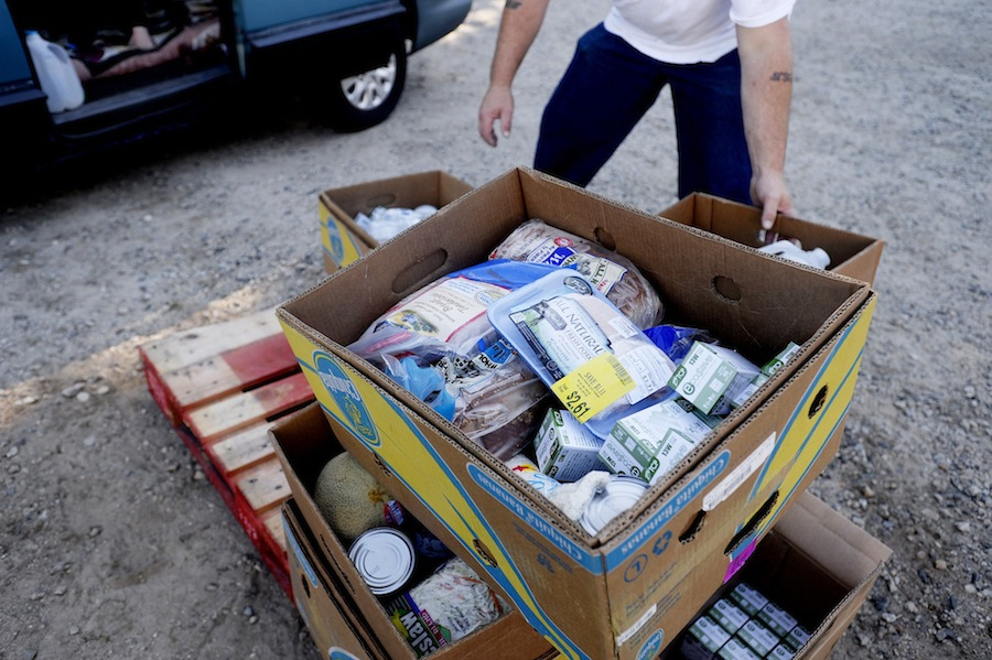 A volunteer grabs a box of food to give to seniors in need at the Good Shepherd Food-Bank Senior Food Mobile event. Good Shepherd Food-Bank announced Thursday it has received a $100,000 grant from the John T. Gorman Foundation to distribute fresh food to Mainers struggling with hunger this winter.