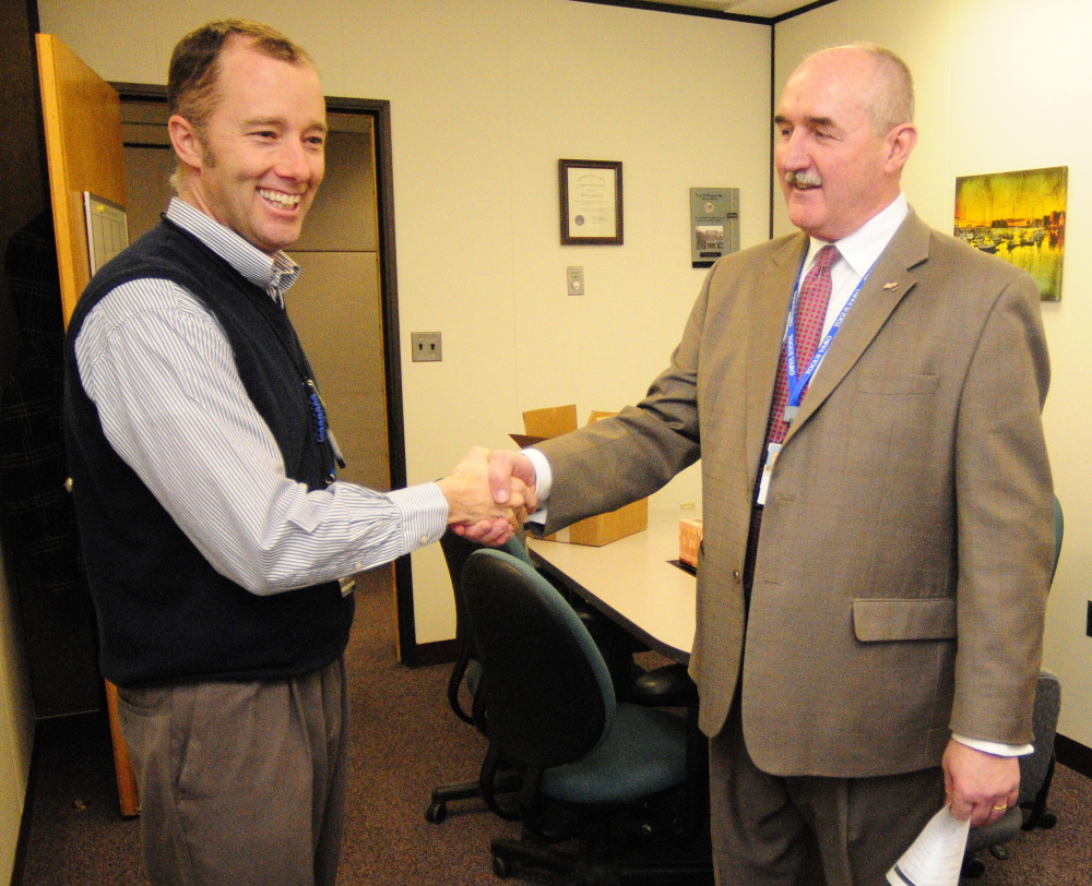RETIRING: Ryan Lilly, director of the VA Maine Healthcare Systems-Togus, left, congratulates Scott Karczewski, the retiring director of the Togus regional office, on Friday.