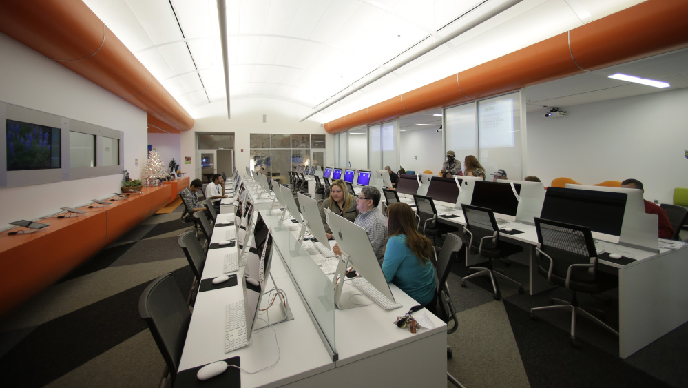 Patrons use computers last month at BiblioTech, a first of its kind digital public library, in San Antonio, Texas.