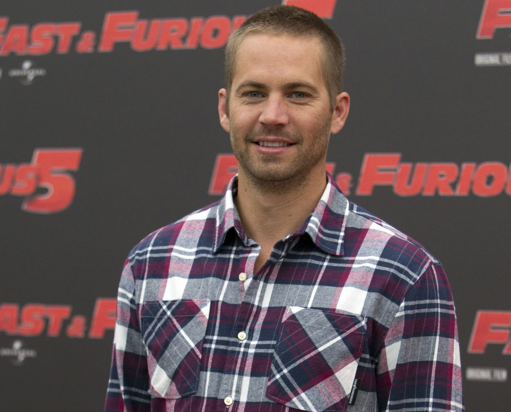 """2011 Associated Press File Photo Actor Paul Walker poses during a photo call for the movie """"Fast and Furious 5,"""" in Rome."""