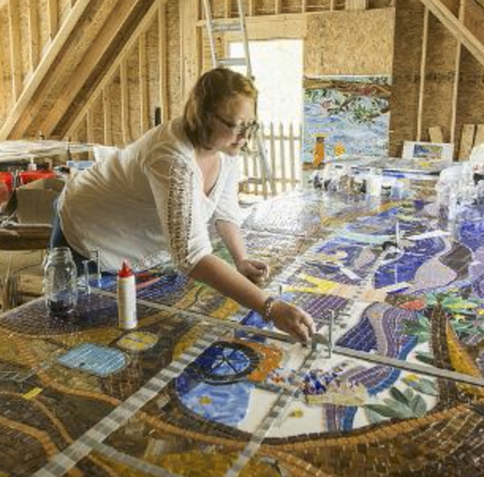 """Amanda Edwards of Cape Elizabeth works on a glass mosaic. """"My work has no big hidden meanings,"""" she says. """"It's just simply color, joy, love and moments of imaginative freedom."""""""