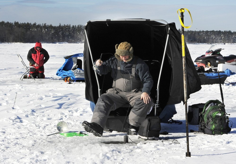 Steve Howland of South Portland and Steve McDougall of Portland jig for togue Saturday at Lower Bay on Sebago Lake.