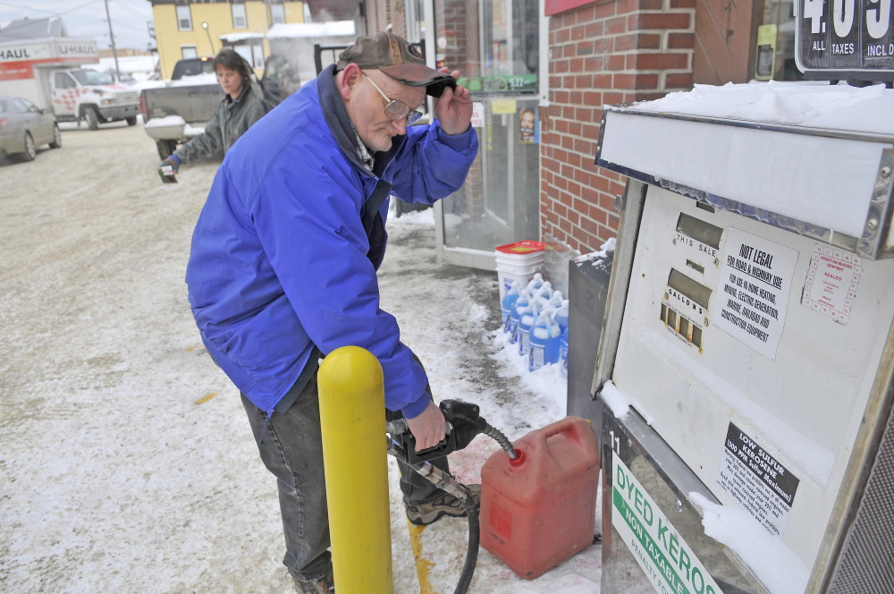 HOME HEAT: James O'Clair, 59, of Waterville, fills a gas can with kerosene at the Big Apple on Elm Street in Waterville on Saturday. O'Clair needs the fuel at home to get him through until Monday when he can have more heating fuel delivered.