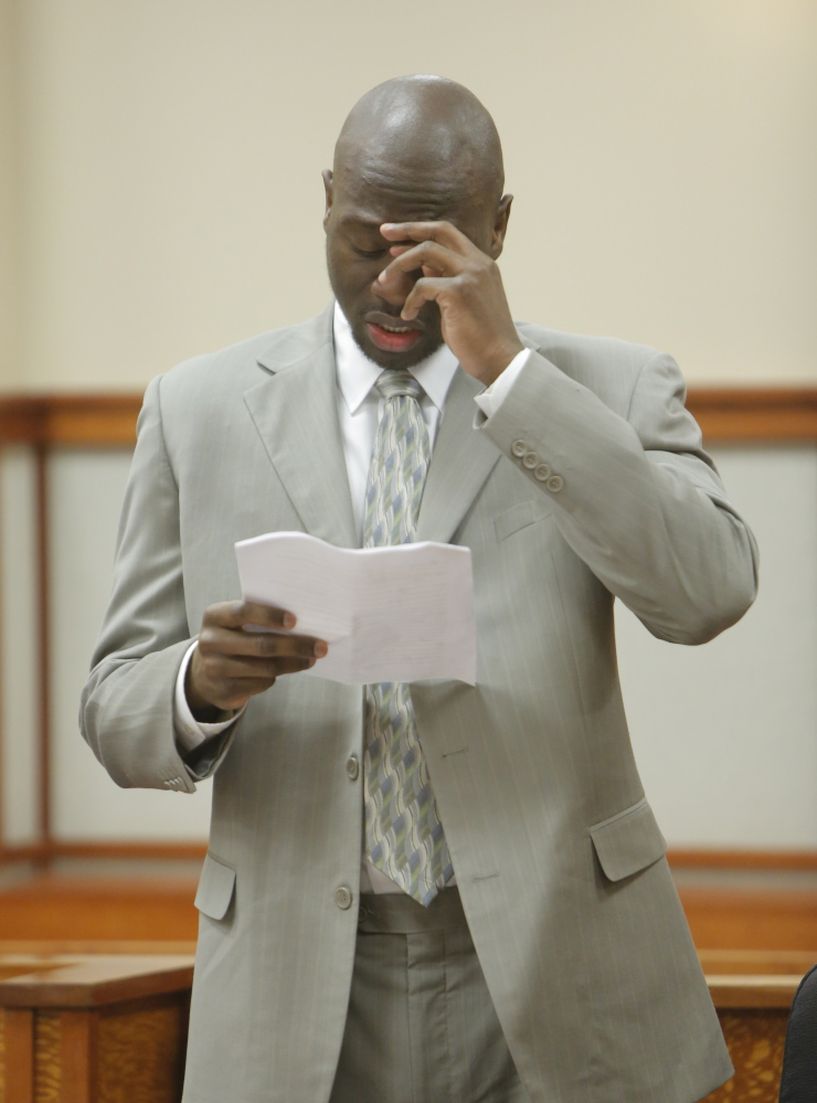 Eric Gwaro becomes emotional as he reads comments during his sentencing in Cumberland County Unified Criminal Court in Portland on Monday. During his comments, Gwaro apologized to Sherri York's family members, who were in the courtroom, for his 2012 attack on York, which left her permanently impaired.