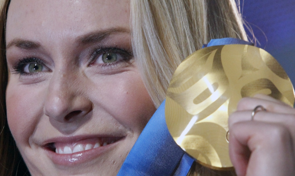 Lindsey Vonn of the United States, shows the gold medal she won in the Women's downhill, during the medal ceremony at the Vancouver 2010 Olympics in Whistler, British Columbia, Canada.
