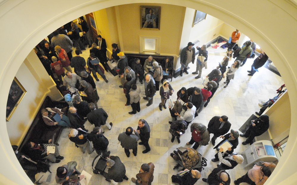 The third-floor hallway between the House and Senate chambers is crowded with people who were part of a large group attending a State House rally in Augusta on Wednesday to support Medicaid expansion as this year's legislative session kicked off.
