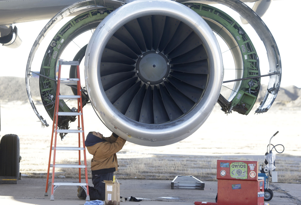 Parts are removed from a retired American Airlines' jet engine in Roswell, N.M.