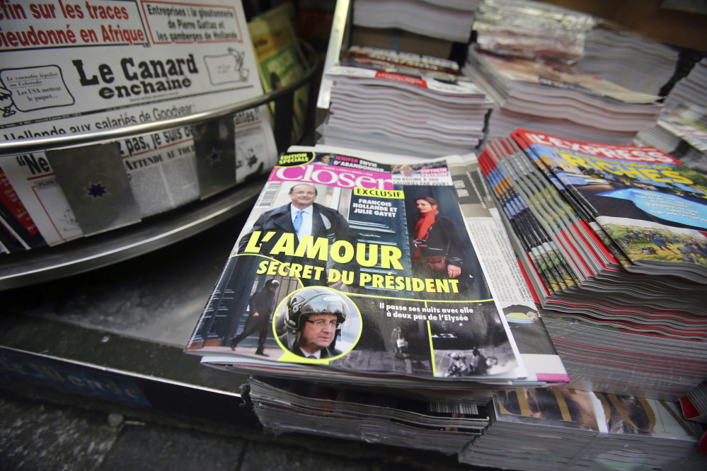 The French magazine Closer, with photos of French President Francois Hollande and French actress Julie Gayet on its front page, is displayed on newspaper rack on the Champs Elysee Avenue in Paris on Friday.