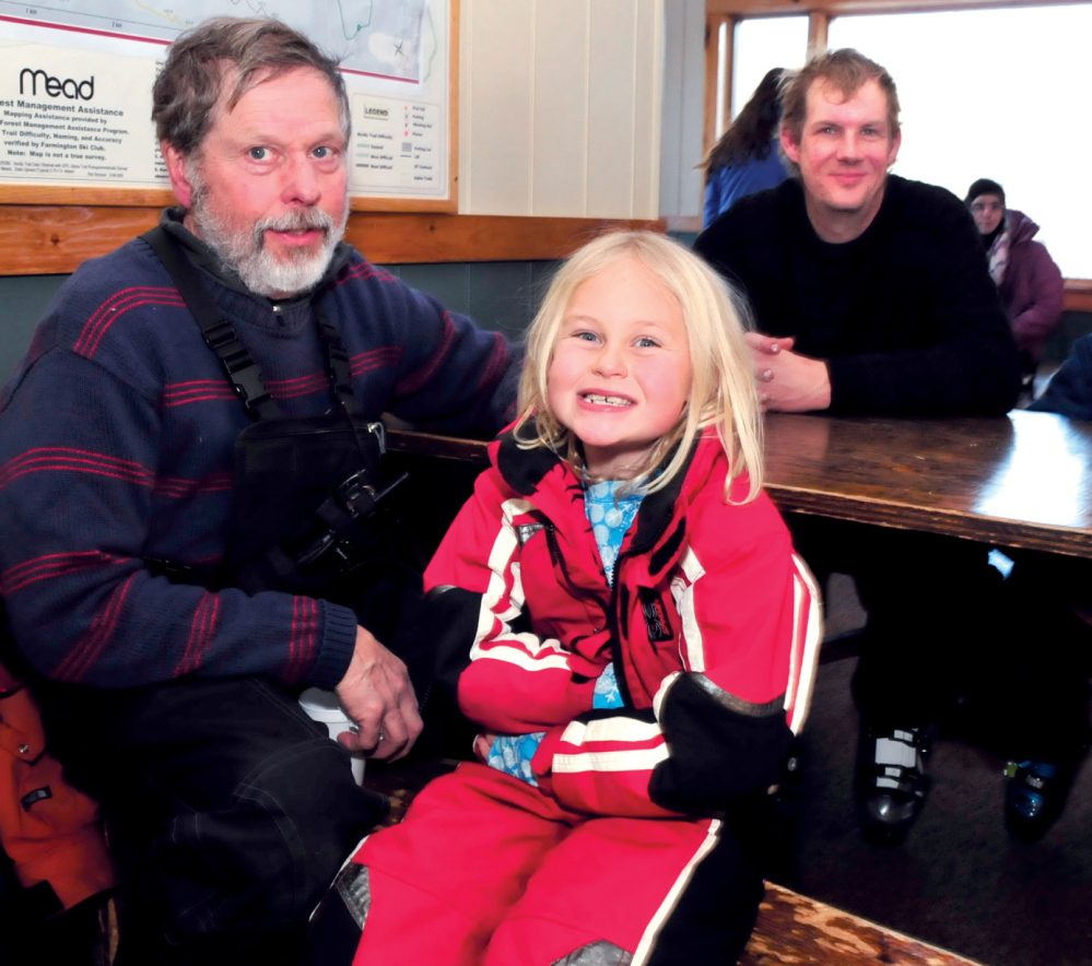 YEARS OF FUN: These patrons of Titcomb Mountain Ski Area in Farmington have nearly 100 years of combined experience at the popular facility. From left are Neal Yeaton who has skied for 58-years at Titcomb with his granddaughter Madie Morton, and Jody Farmer who has patronized Titcomb for 35-years.