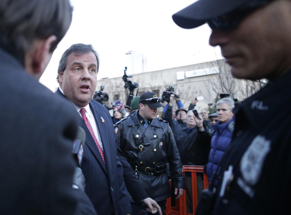 New Jersey Gov. Chris Christie leaves after a visit City Hall Thursday, in Fort Lee, N.J.