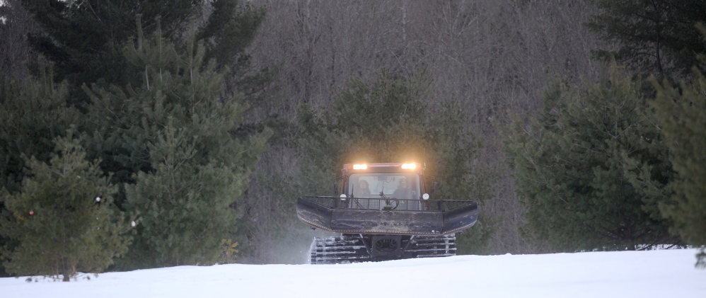 COLD JOBS: Steven Buzzell, the grounds mechanic for Waterville Parks and Recreation, grooms part of 7 miles of nordic ski trails at Quarry Road Recreational Area recently.