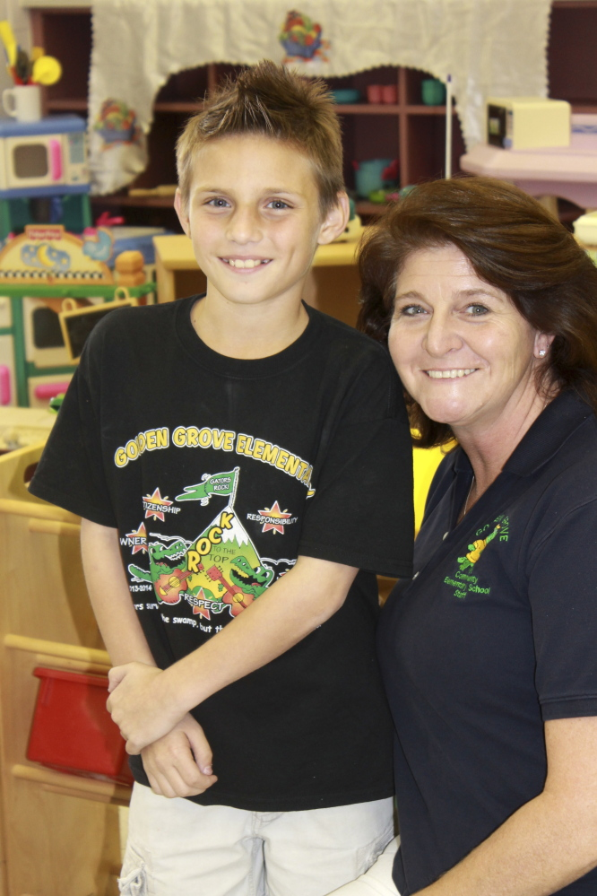 Matthew Palma poses for a photo with Stephanie Dana-Schmidt during a play therapy session at school in West Palm Beach, Fla. Thanks to the Primary Project, Matthew's mom says his confidence improved dramatically and the now fifth grader isn't afraid to talk to adults or raise his hand in class.