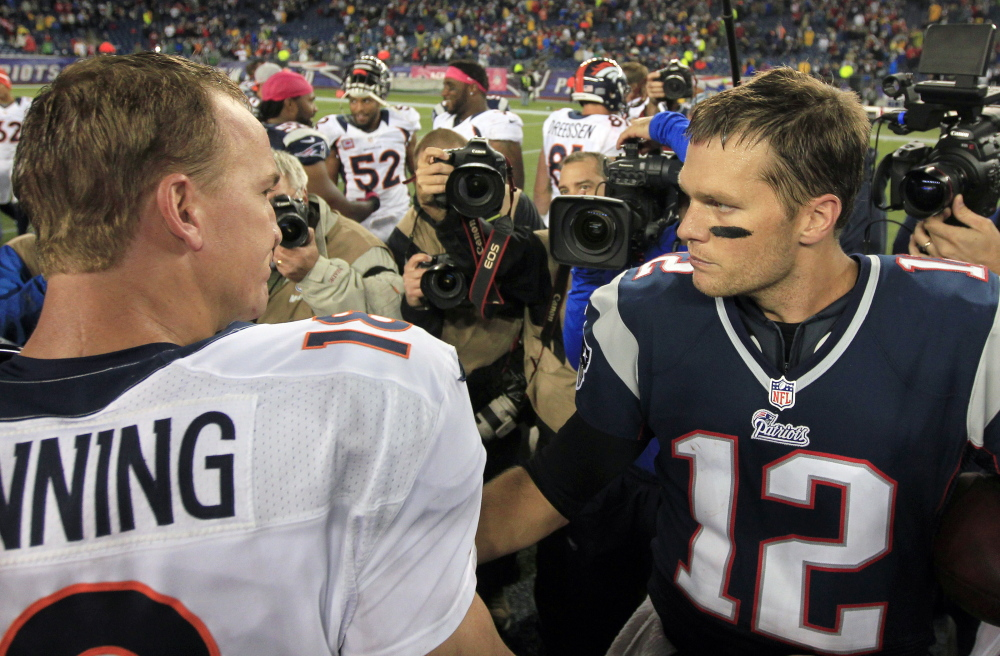 Denver Broncos quarterback Peyton Manning, left, and New England Patriots quarterback Tom Brady, right, speak in the middle of the field after the Patriots beat the Broncos in a 2012 game. The quarterbacks will face each other for the 15th time in the AFC championship game next Sunday.