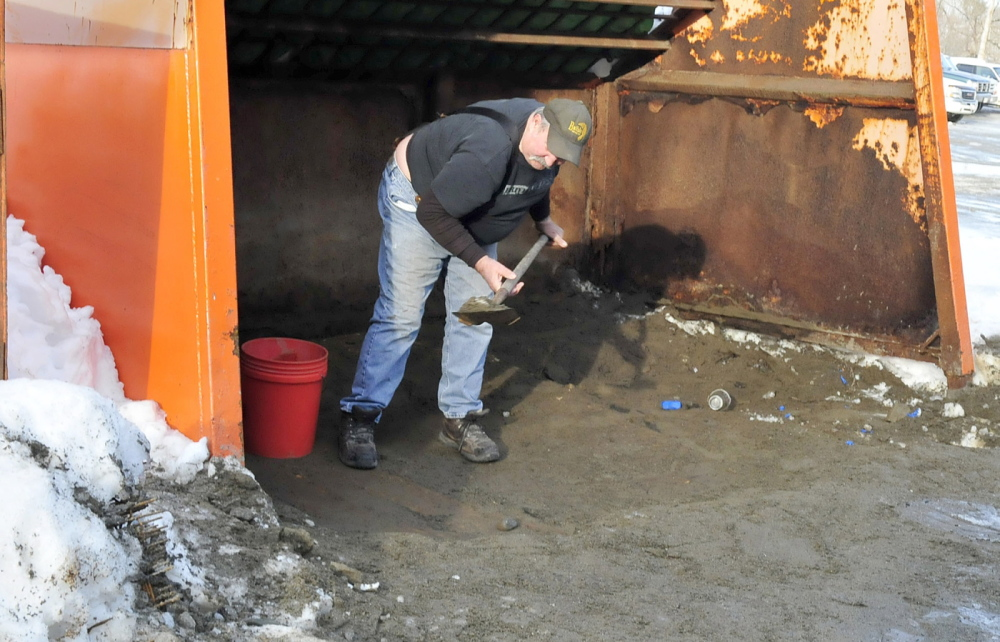 JUST SCRAPING BY: Norridgewock resident Sid Smith scrapes the last of the sand that was available to the public at the town Public Works department. The town is no longer allowing residents to pick up sand because of a shortage from heavy use this winter.