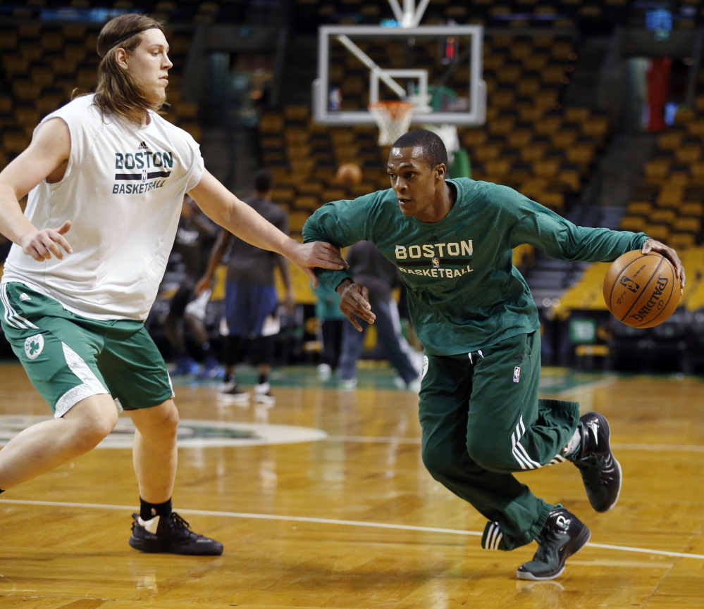 Boston Celtics' Rajon Rondo, right, works out with teammate Kelly Olynyk in Boston last month. Rondo was assigned to work out with the Maine Red Claws on Wednesday as he recovers from a knee injury.