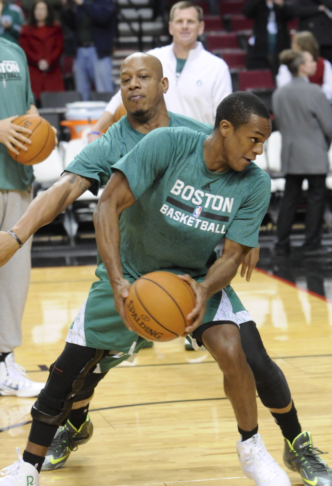 Boston Celtics' Rajon Rondo who is on the injured list works on drills with a team mate prior to an NBA basketball game in Portland, Ore., Saturday Jan.11, 2014. (AP Photo/Greg Wahl-Stephens)