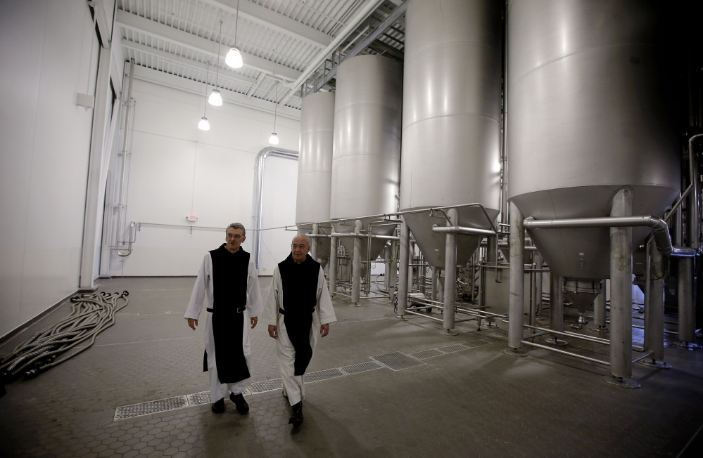 Father Damion, abbot at St. Joseph's Trappist Abbey, left, and Spencer Brewery Director Father Isaac walk through their new, state-of-the-art facility in Spencer, Mass., this month. The Spencer Brewery began brewing Spencer Trappist Ale recently, becoming only the ninth certified brewery of Trappist beers in the world and the only one outside of Europe.