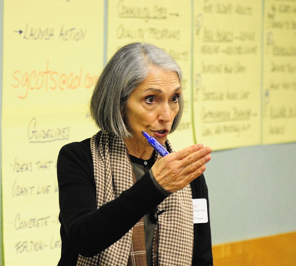 Stephanie Cotsirilos facilitates a session during the Maine Summit on Aging on Friday in Augusta.