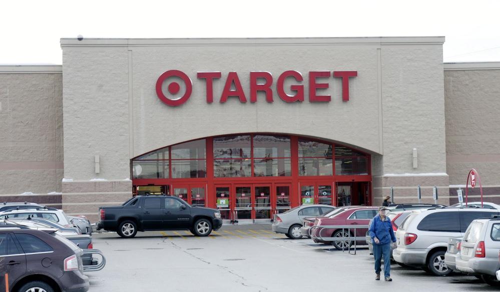 A shopper leaves Target in South Portland on Dec. 19, 2013.