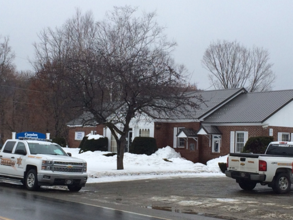 bank Robbery: Somerset County Sheriff's officers on scene Friday at Camden National Bank on Main Street in Bingham, which was robbed by a man armed with a hammer.