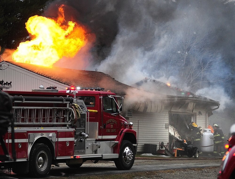 FIRE IN PITTSTON: Firefighters battle a blaze on Saturday in a large attached garage at 1083 Wiscasset Road in Pittston. Pittston, Gardiner, West Gardiner, Dresden, Wiscasset, Whitefield, Chelsea, Farmingdale and Randolph responded to the fire, which was reported around 3 p.m.