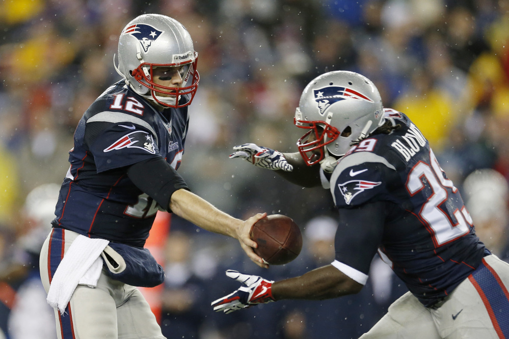 Patriots quarterback Tom Brady hands off the ball to running back LeGarrette Blount in last Saturday's AFC playoff game against the Colts.