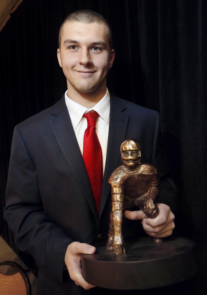 Derek Davis/Staff Photographer: Ben Lucas, quarterback for Cony High School, won the James L. Fitzpatrick Trophy, Sunday, Jan. 19, 2014, at Holiday Inn by The Bay in Portland.