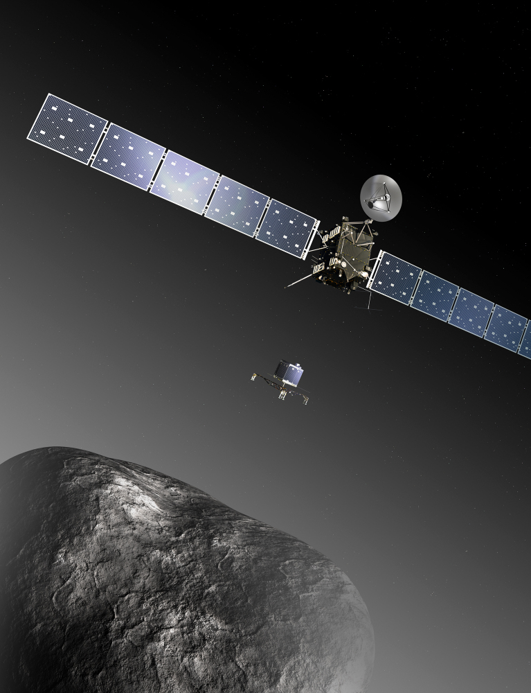 This image provided by the European Space Agency ESA shows an artist's impression of the Rosetta orbiter deploying the Philae lander to comet 67P/ChuryumovñGerasimenko. The image is not to scale; the Rosetta spacecraft measures 104 feet across including the solar arrays, while the comet nucleus is thought to be about 2.5 miles wide. Scientists at the European Space Agency are expecting their comet-chasing orbiter to wake from almost three years of hibernation on Monday and phone home to say all is well.