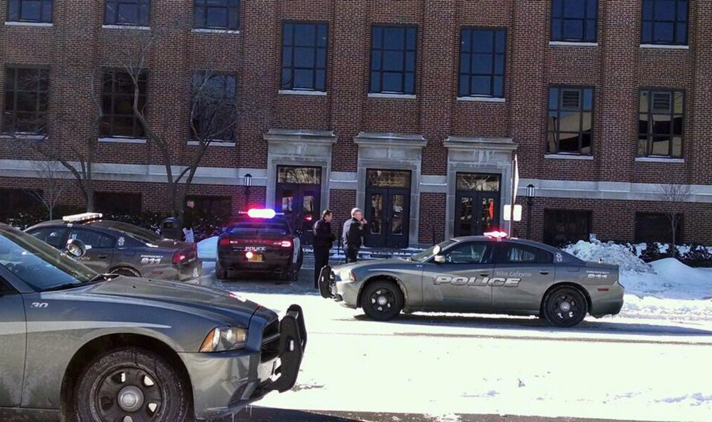 Police investigate reports of a shooting at Purdue University in West Lafayette, Ind., on Tuesday. Police say they have a person in custody and the university says it told people to take shelter and have cleared the building as the area is searched.
