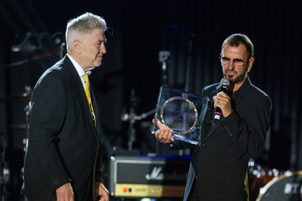 """Director David Lynch, left, presents musician Ringo Starr with the ìLifetime of Peace & Love Awardî on stage during the David Lynch Foundation Honors Ringo Star """"A Lifetime of Peace & Love"""" event held at the El Rey Theatre on Monday in Los Angeles."""
