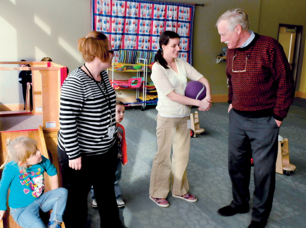 BACK TO SCHOOL: U.S. Sen. Angus King speaks with Educare Central Maine employees Jessica Field, left, and Amy Pinkham in one of the classrooms at the Waterville facility on Wednesday, Jan. 22, 2014.