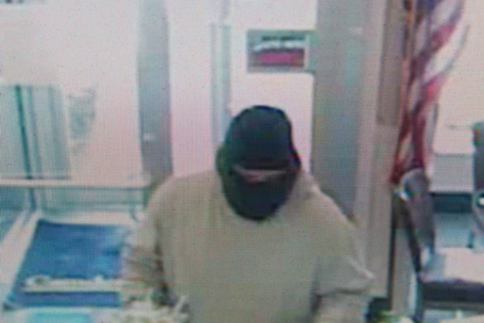 ROBBERY SUSPECT: Police have released this surveillance image of a man who robbed Camden National Bank in Bingham last Friday, armed with a hammer.