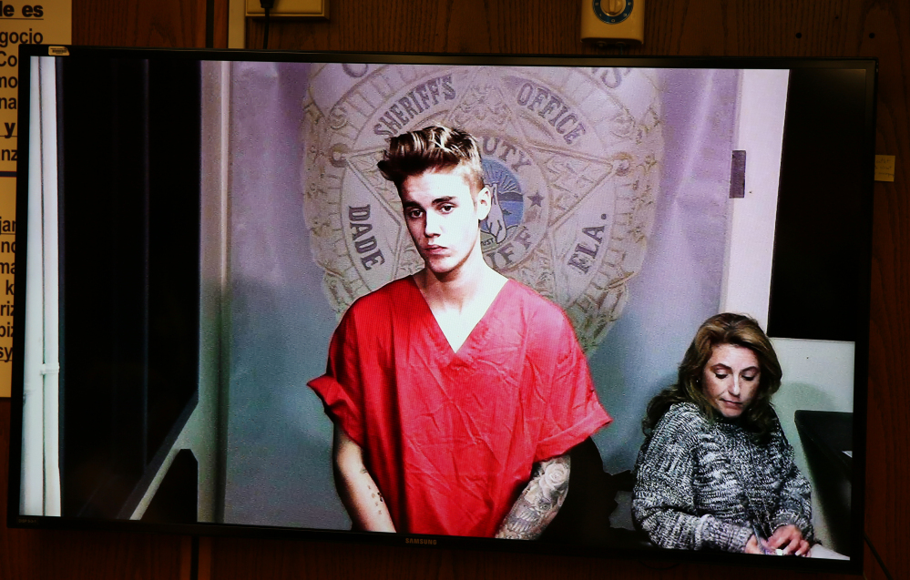 Justin Bieber appears in court via video feed Thursday in Miami.