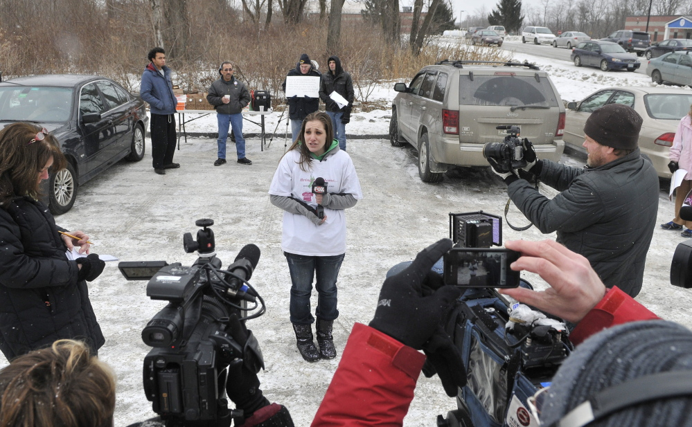 speaking out: Trista Reynolds, mother of missing toddler Ayla, speaks to the news media Saturday outside the Waterville police station during a Push for Prosecution protest.