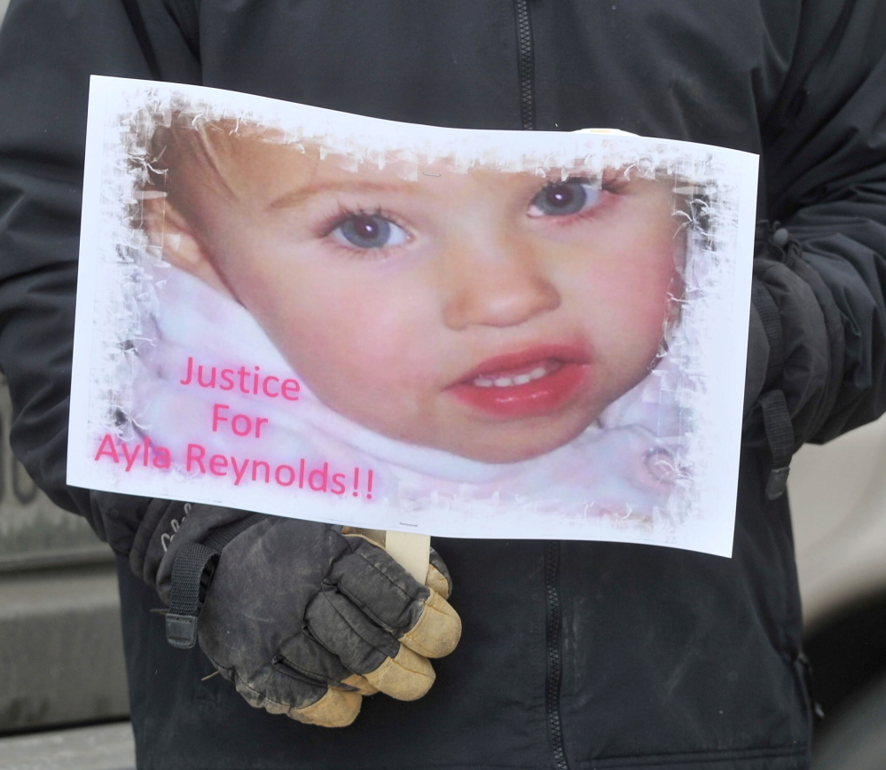 poster child: A poster with the image of missing toddler Ayla Reynolds was one of many signs on hand at a demonstration Saturday at the Waterville police station.