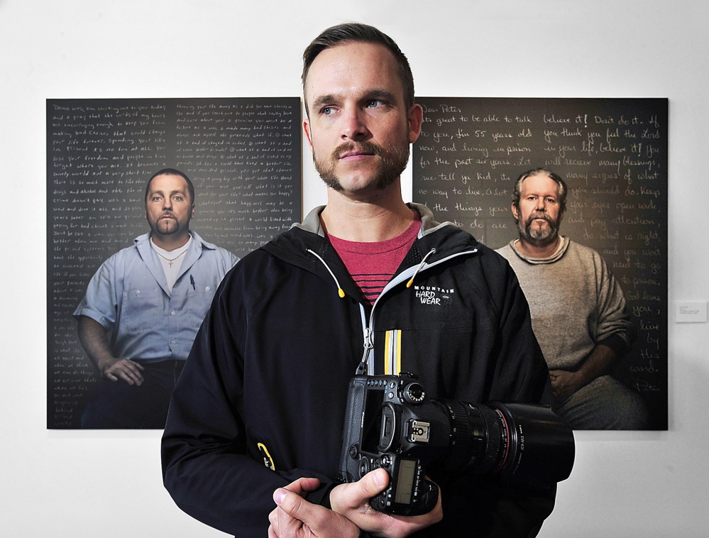 Trent Bell stands in front of portraits at the Engine gallery in Biddeford. Behind him is Wesley Knight, left, convicted of murder, and Peter Mills, convicted of gross sexual assault. Bell said the exhibit does not seek to glorify the convicts or minimize their crimes, but may offer lessons that could prevent future victims' suffering.