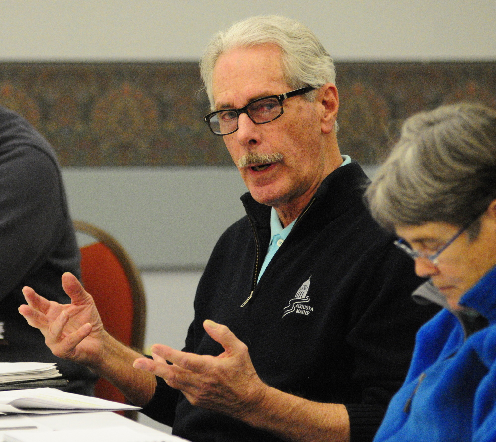 LOOKING AHEAD: Councilors Cecil Munson, left, speaks during the Augusta City Council goal-setting meeting Saturday in the Augusta Civic Center. Councilor Dale McCormick is at right.