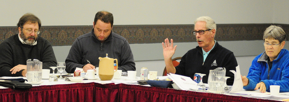 WHAT THE FUTURE HOLDS: Cecil Munson, second from right, speaks as fellow City Councilors Mark O'Brien, far left, Darek Grant, and Dale McCormick, far right, listen during a goal-setting meeting on Saturday in the Augusta Civic Center.