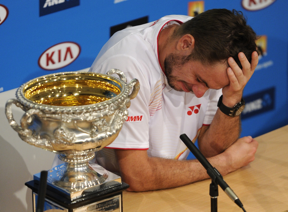 Stanislas Wawrinka is very emotional at a press conference Sunday after defeating Rafael Nadal in the men's singles final at the Australian Open.
