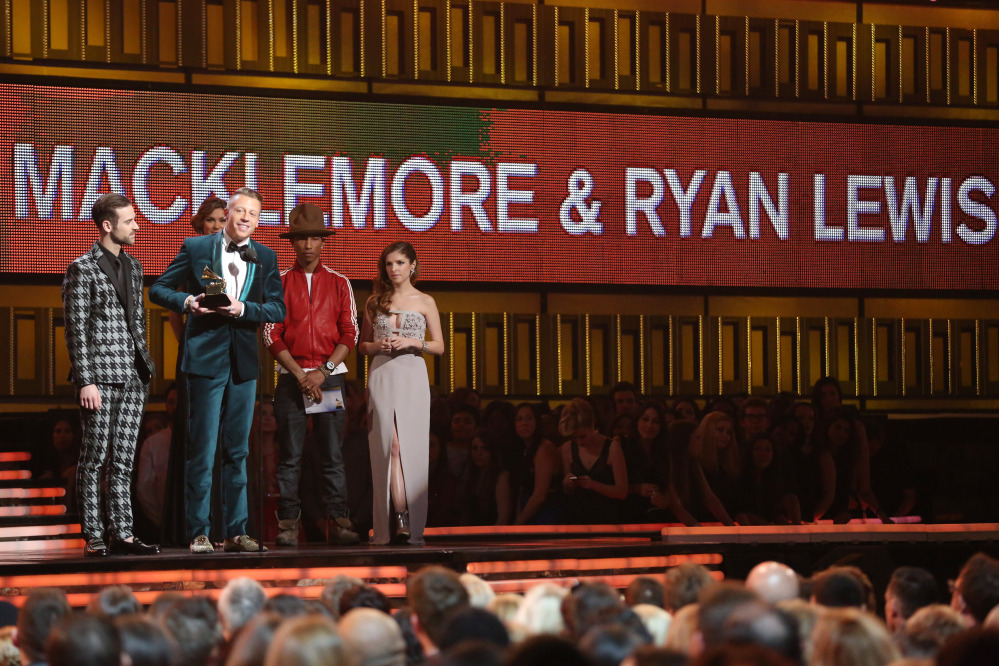 Ryan Lewis, left, and Macklemore, second left, accept the award for best new artist from presenters Anna Kendrick, right and Pharrell Williams at the 56th annual Grammy Awards at Staples Center on Sunday.