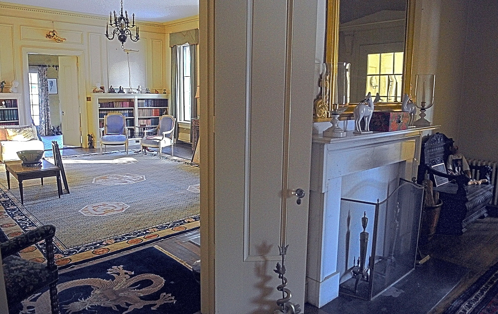 the parlor, left, and entry way of the Daniel Cony Weston House on Stone Street that's home to the Elsie & William Viles Foundation in Augusta on Thursday January 23, 2014.